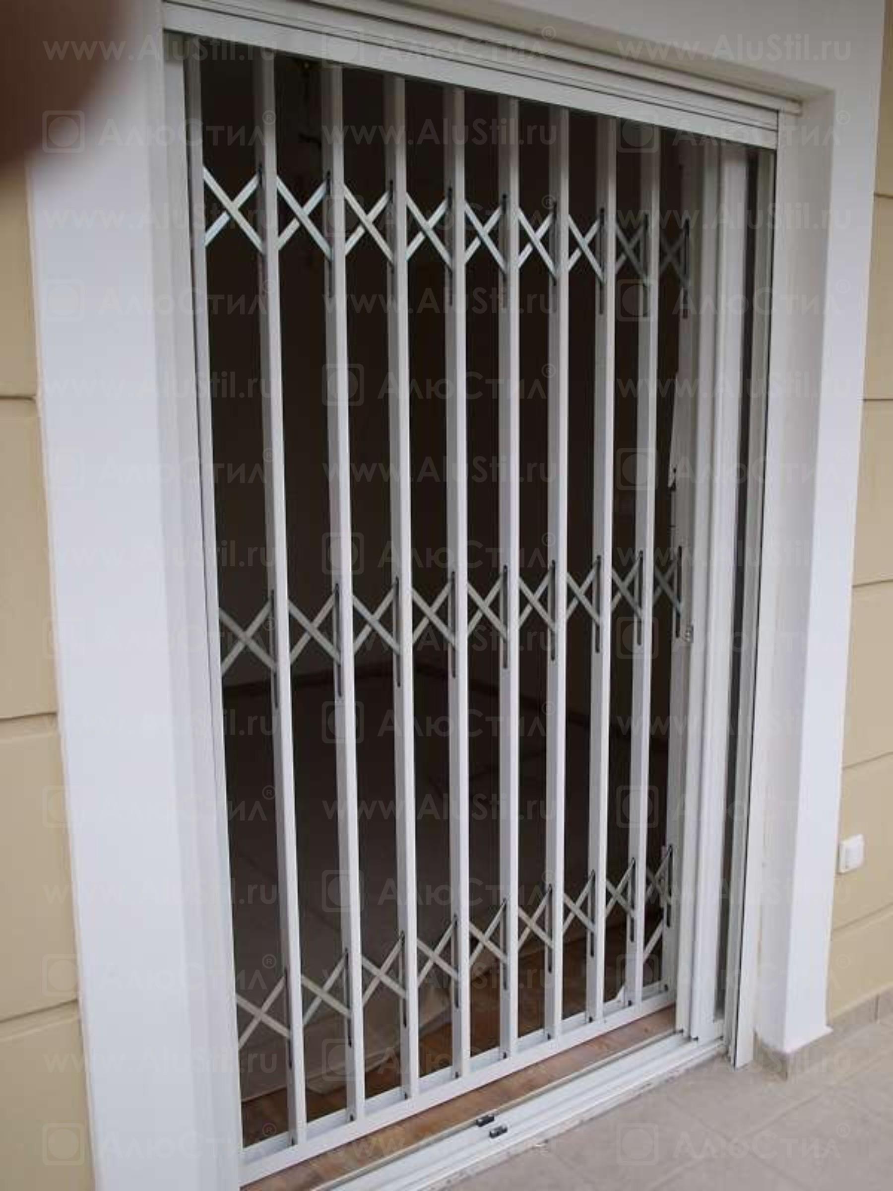 раздвижная решётка алюстил для выхода на балкон