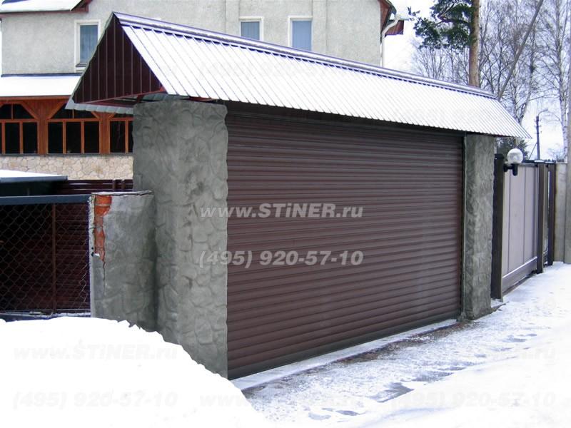 Рулонные коричневые ворота для заезда домой